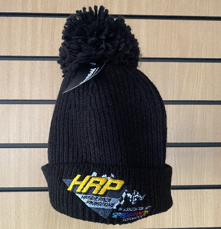 Black ribbed hat with bobble, embroidered with the HRP logo.<br />